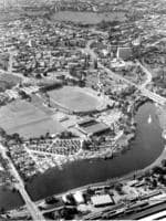 The aerial view of Adelaide in 1964 - you can see the city, Adelaide Oval, the River Torrens, cars parked on Pinky Flat and the parklands.