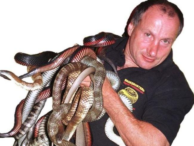 Hoser holding a mixture of dangerous snakes.