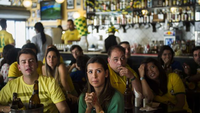 Brazilian supporters sitting in a bar in Mogi das Cruzes, Brazil.