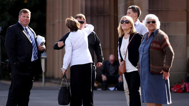 Liams mum Mary Knght (in white) hugs party host Phil Staples.