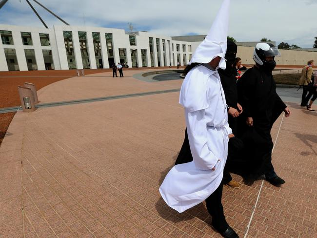 "Wearing disguises, members of Sydney protest group ""Faceless"" protest at Parliament House in Canberra."