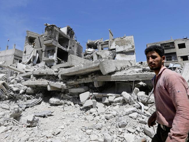 A Syrian man walks past rubble in Douma on the outskirts of Damascus on April 16, 2018. Picture: AFP PHOTO