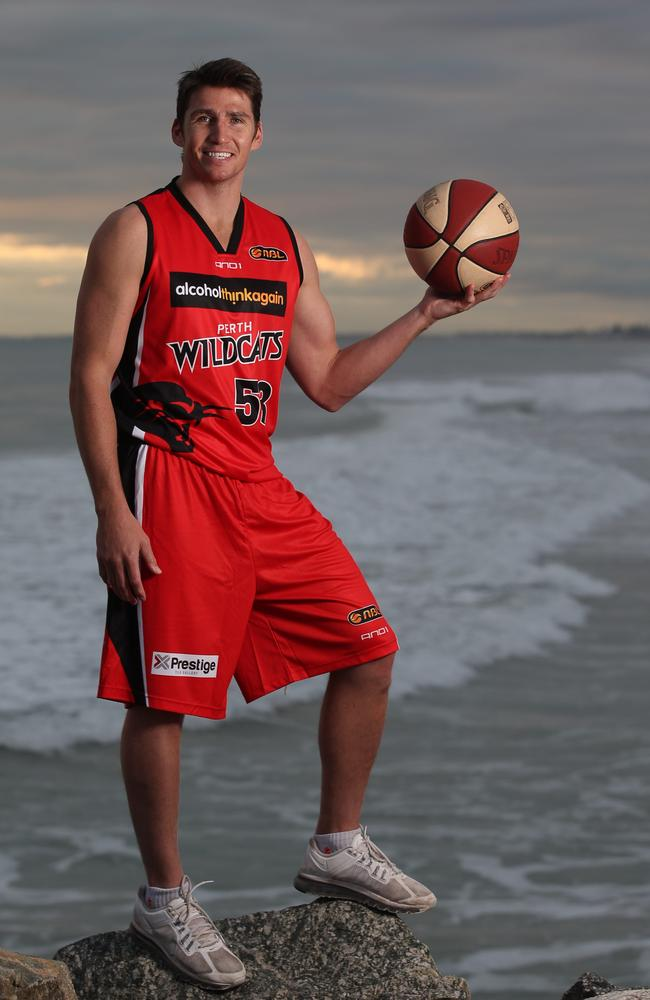 Perth Wildcats captain Damian Martin took the surf in City to Surf literally for his training. Photo: Ross Swanborough