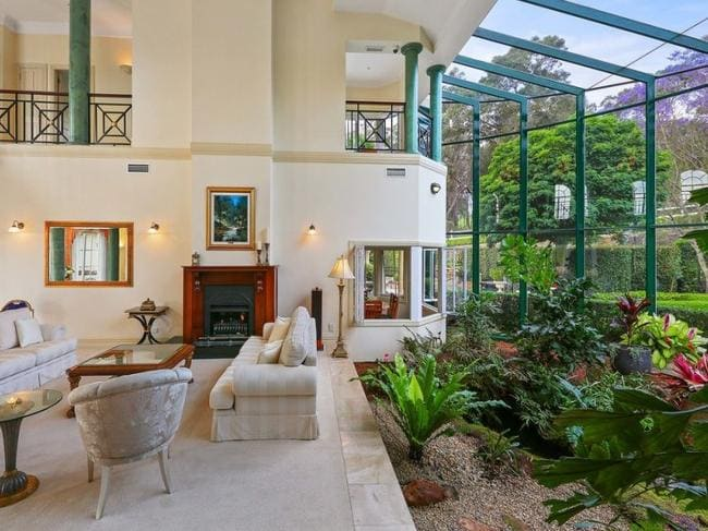 Sydney mansion with internal creek and waterfall to fetch for Garden rooms finance