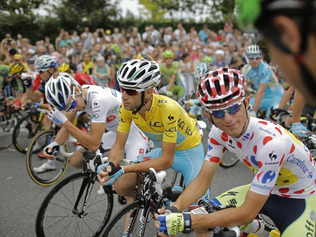France's Thibaut Pinot, wearing the best young rider's white jersey, Vincenzo Nibali, wearing the overall leader's yellow jersey, and Poland's Rafal Majka, wearing the best climber's dotted jersey.