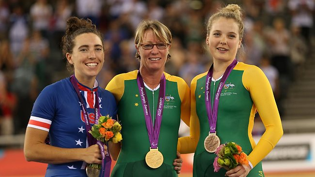 Gold medalist Susan Powell of Australia stands with silver medalist Megan Fisher of the United States, and bronze medalist Alexandra Green of Australia in the Women's Individual C4 Pursuit.