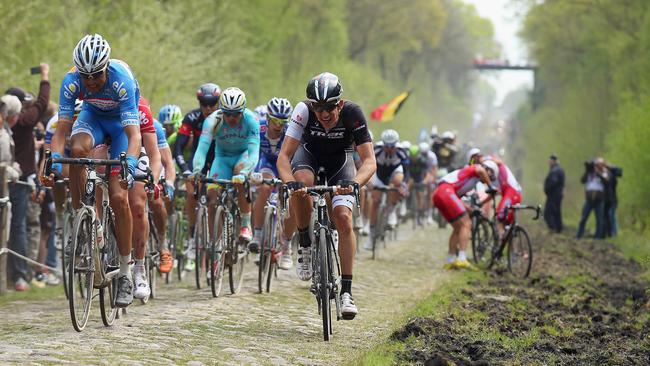 The riders won't be subjected to the horrors of the Arenberg forest (pictured) this year, but there'll be plenty of cobblestones just like it.