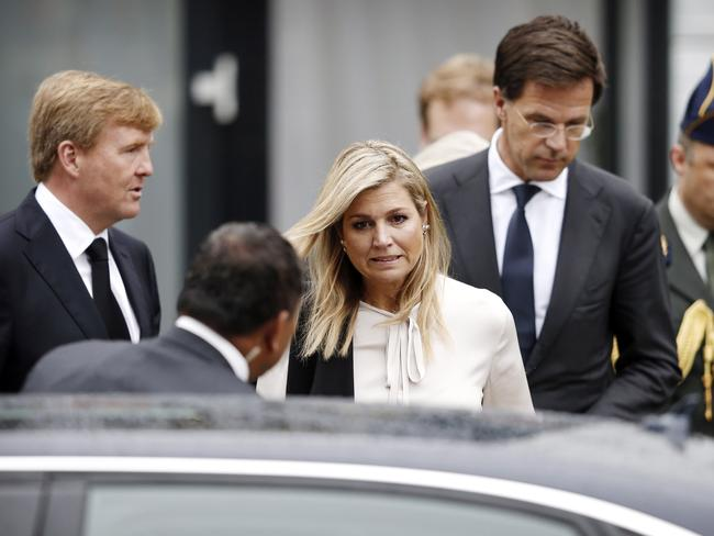 'A deep wound' ... Dutch King Willem-Alexander (left), Queen Maxima (centre) and Prime minister Mark Rutte (right) leave after meeting relatives of victims of MH17 in Utrecht. Picture: Jerry Lampen