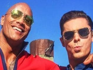 """The Rock and Zac Efron EXCLUSIVE FIRST LOOK: #BAYWATCH Day 1. My character """"Mitch Buchannon"""" just gave @zacefron's character """"Matt Brody"""" the all important beach speech about what it means to have manly """"Alpha balls"""". Zac's ad-libbed responses were brilliant! Talented and great dude. World get ready to have some fun, 'cause the beach will never be the same again. #OnSet #BAYWATCH #Day1 #AlphaBalls #NowWhoNeedsMouthToMouth? Picture: Instagram"""
