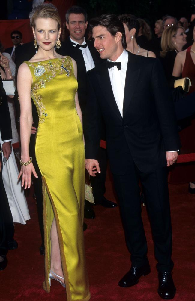 A Dior-clad Nicole Kidman, pictured with her then-husband Tom Cruise, at the Oscars in 1997. Picture: WireImage