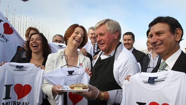 Then prime minister Julia Gillard with Henry Jones in Canberra, spearheading The Advertis