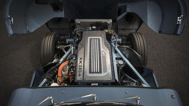 You did what to a Jaguar E-Type? The electric motor and battery pack fit neatly under the bonnet in lieu of the six-cylinder engine. Picture: Supplied.