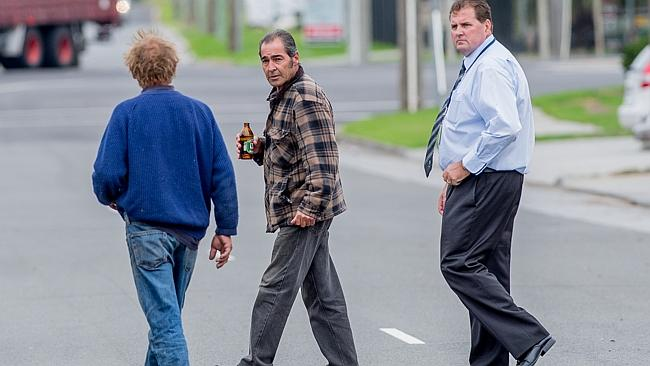 A detective takes Kevin Featherston (centre) and a friend back to the scene of Rani Featherston's murder.