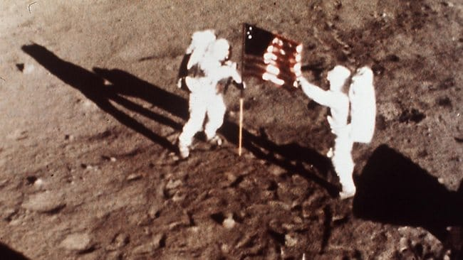Apollo 11 astronauts Neil Armstrong and Edwin E 'Buzz' Aldrin, the first men to land on the moon, plant the USA flag on the lunar surface in 1969.