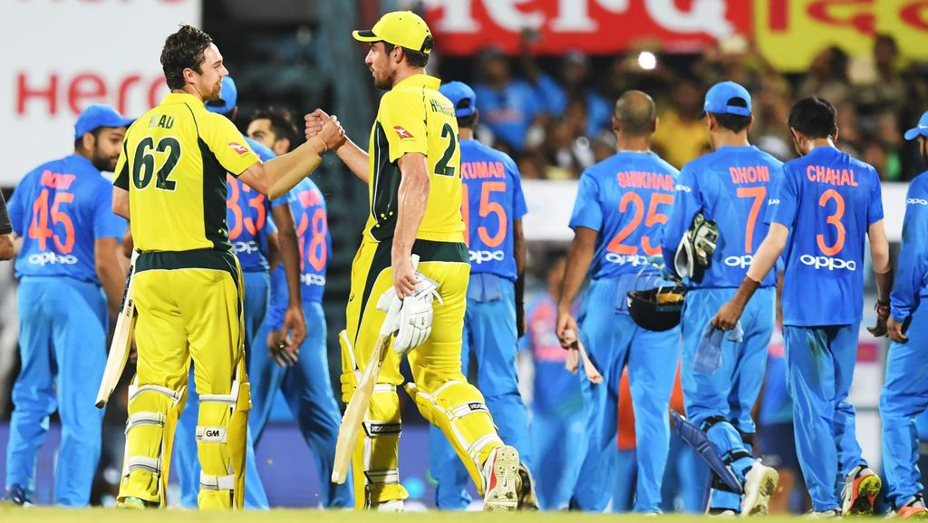 Moises Henriques (R) and Travis Head celebrate a rare win on the limited-overs tour of India.