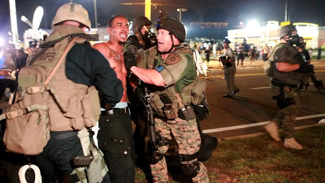 Suburb erupts ... a protester is detained during the Ferguson riots. Picture: AP Photo/St. Louis Post-Dispatch, Christian Gooden