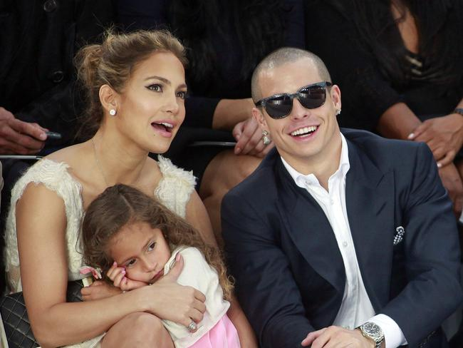 Family time ... Lopez, Smart and her daughter Emme take in a Chanel fashion show in Paris in 2012. Picture: AP