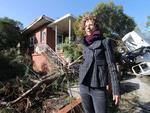 The scene of storm damage in Clarke Street, O'Connor. Amber Jones outside her home. Picture: Ross Swanborough