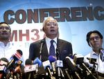 Malaysian Prime Minister Najib Razak, center, Malaysia's minister for transport Hishamuddin Hussein, left, and director general of the Malaysian Department of Civil Aviation, Azharuddin Abdul Rahman, right, delivers a statement to the media regarding missing Malaysia Airlines jetliner MH370, Saturday, March 15. Picture: AP Photo/Wong Maye-E