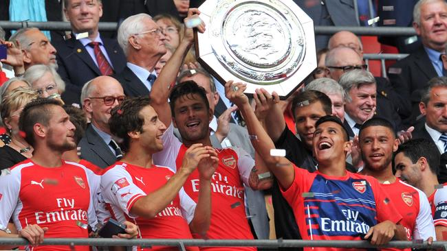 Giroud and Sanchez enjoy the spoils of an early trophy.