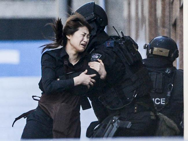 Police attend a siege in the Lindt shop in Sydney's Martin Place. Photos: Chris McKeen