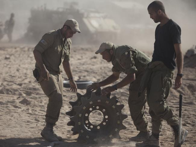 Israeli soldiers prepare their tanks in a deployment area on Israel's border with the Gaza Strip. Picture: Getty