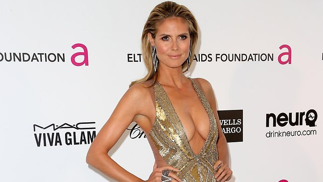Heidi Klum arrives at the 21st Annual Elton John AIDS Foundation party wearing the dress that prompted the remarks by Joan Rivers.