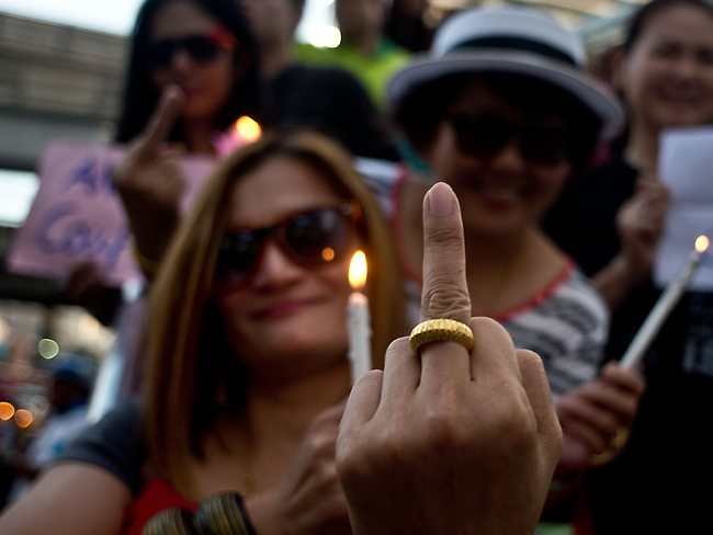 No holding back ... anti-coup protestors gesture during a protest in downtown Bangkok.