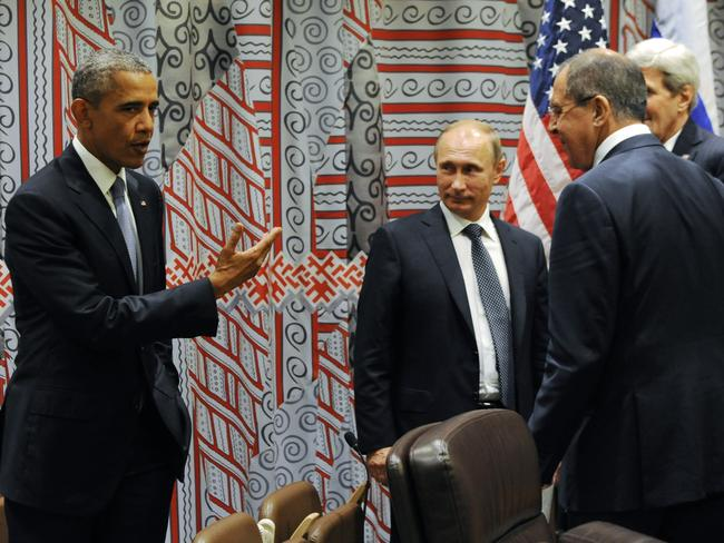 Obama (left) gestures towards Putin ahead of a bilateral meeting at United Nations headquarters in New York. Picture: Mikhail Klimentyev, RIA-Novosti, Kremlin Pool Photo via AP.