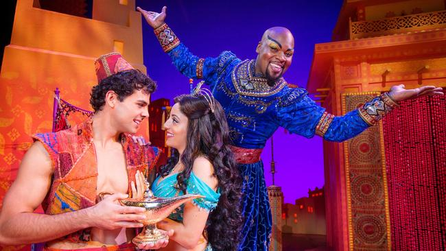 Ainsley Melham as Aladdin, Hiba Elchikhe as Princess Jasmine and Michael James Scott as Genie in Aladdin.