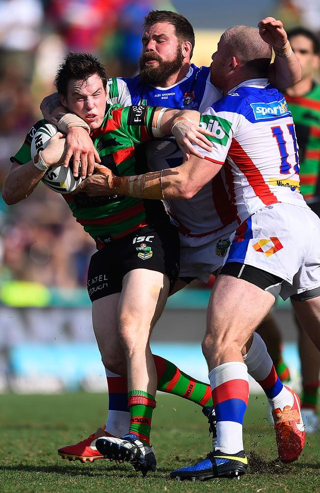 Luke Keary of the Rabbitohs is tackled by Beau Scott and Adam Cuthbertson.