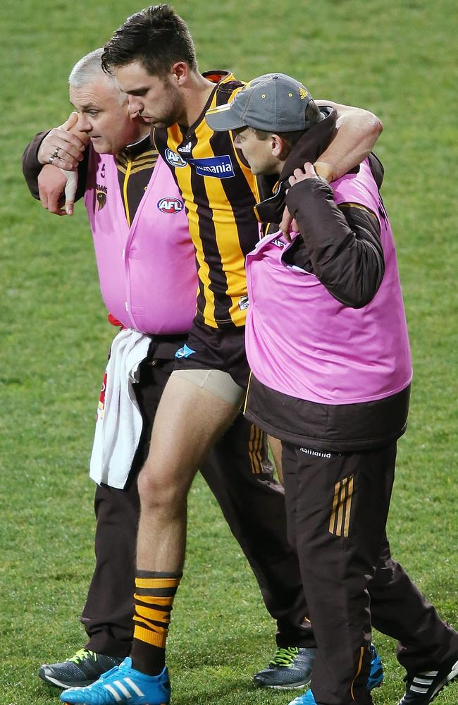 Jack Gunston limps off after hurting his ankle in the final quarter.