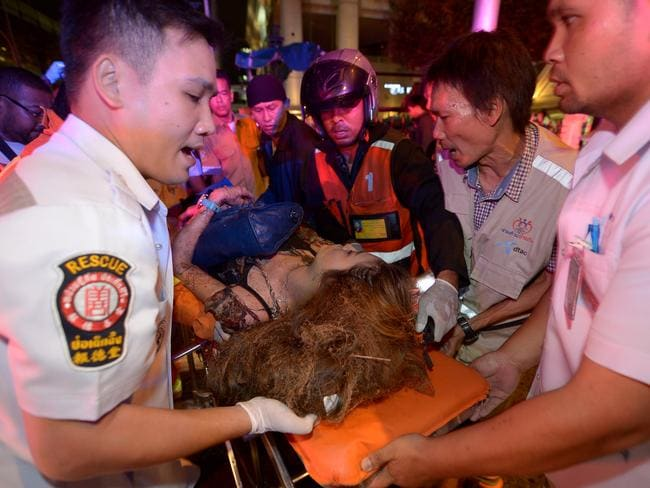 Horrific injuries ... Witnesses said a number of people around the shrine were hit with the full force of the blast. Picture: AFP/Pornchai Kittiwongsakul