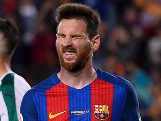Barcelona's Argentinian forward Lionel Messi gestures during the Spanish league football match FC Barcelona vs SD Eibar at the Camp Nou stadium in Barcelona on May 21, 2017. / AFP PHOTO / Josep LAGO