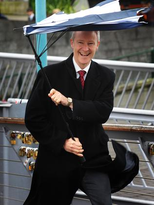 This pedestrian had fun battling the weather with his umbrella. Picture: Ellen Smith