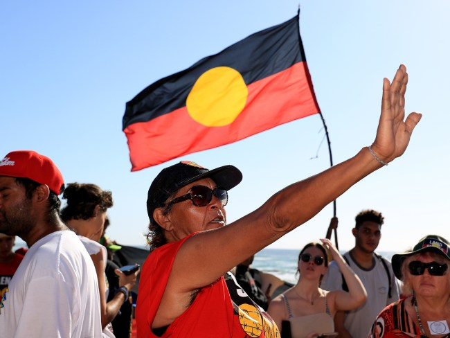 A protester during the Sunrise broadcast on the Gold Coast. Photo: Adam Head
