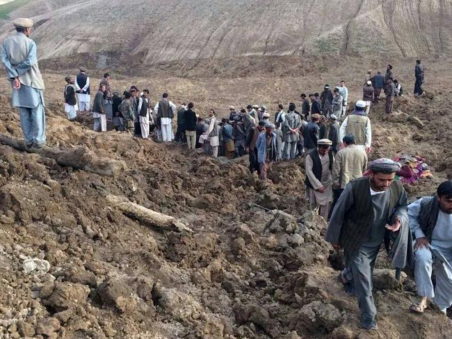 Hundreds dead ... Afghans search for survivors after a massive landslide buried a village