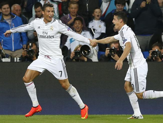 Real Madrid's Cristiano Ronaldo celebrates with james Rodriguez after scoring his second goal.