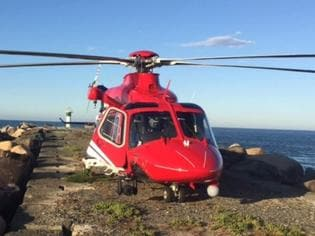 A Rescue 500 helicopter retrieved the man from South Stradbroke Island.