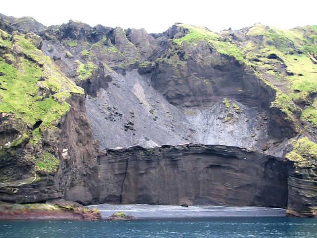 Ash from Eldfell volcano comes down to the waters edge on the island of Heimaey. Picture: Michael Clarke Stuff.