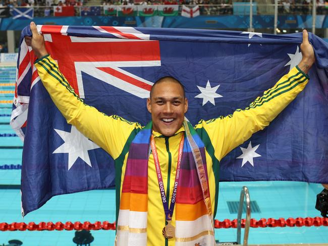 Geoff Huegill wins gold at the Comm Games 2010