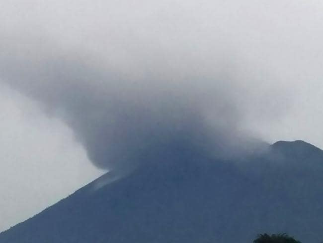 Mount Agung volcano spewing smoke in Bali as it erupts. Picture: AFP/Indonesia's Disaster Mitigation Agency