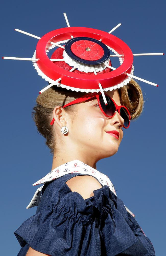 A racegoer poses on Melbourne Cup Day at Flemington Racecourse. Photo by Mark Metcalfe.