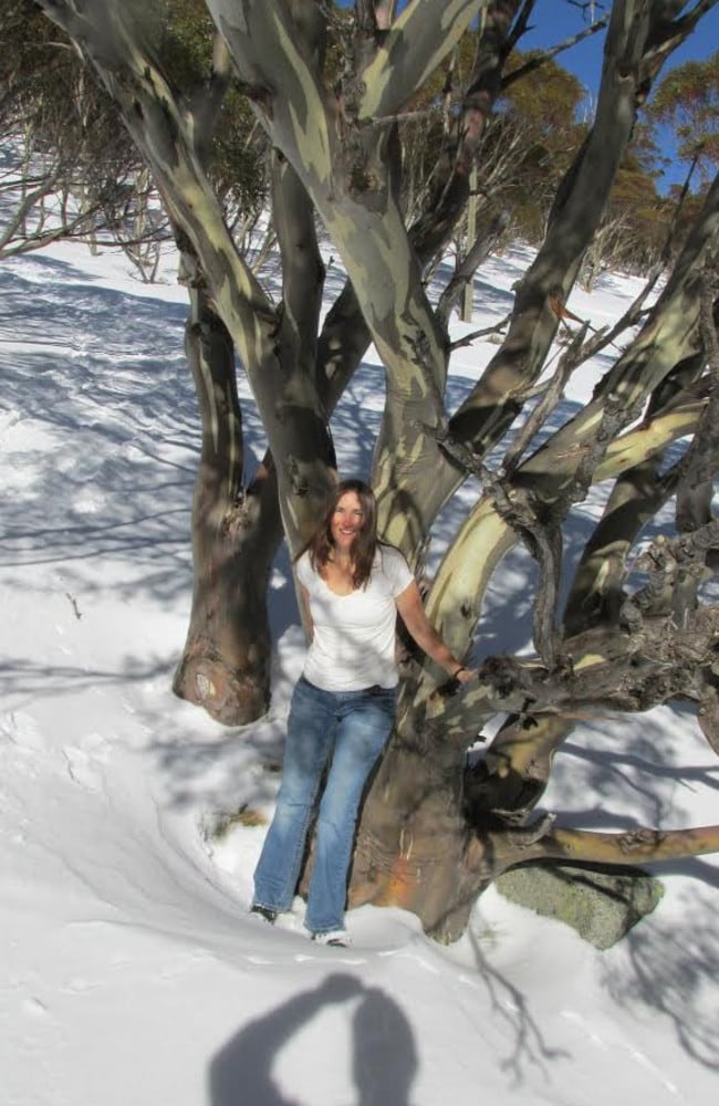 Alli Schneider, lodge manager at Southern Alps Ski Club lodge, catches a few rays among the snowgums after a night of minus 16 at Charlotte Pass. As you do.