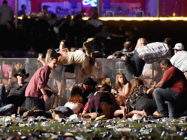 People scramble for shelter at the Route 91 Harvest country music festival after gun fire was heard. Picture: Getty