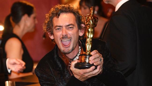 Sound Mixer David White intensely enjoying his win at the Governors Ball after the Oscars on Sunday. Picture: Al Powers / Invision / AP