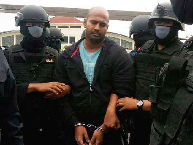 Brutal end .... Sukumaran was tied to a wooden pole for execution. Picture: AFP