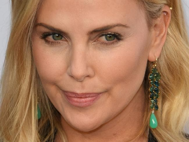 Charlize Theron arrives for the premiere of Netflix's 'Girlboss' at ArcLight Cinemas in Hollywood, California on April 17, 2017. / AFP PHOTO / Mark RALSTON