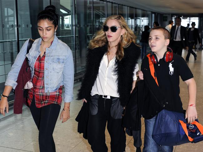 Jetsetters ... Madonna, Lourdes and Rocco leave London's Heathrow Airport for the US in 2011. Picture: AP Photo