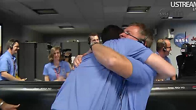 NASA staff celebrate the landing of rover Curiosity on Mars.